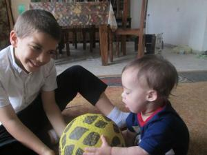 Once Yirmiyahu learned to sit us, ds7 decided it was time to teach him to play ball