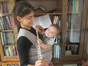 Loving his sister's flute!